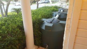 water tanks hidden by trees